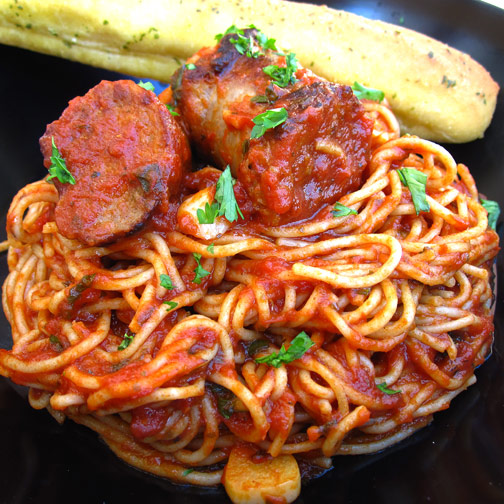 Sausage with Tomatoes and Garlic on Spaghetti