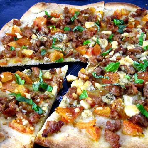 Premio pizza with heirloom tomatoes, basil and gorgonzola