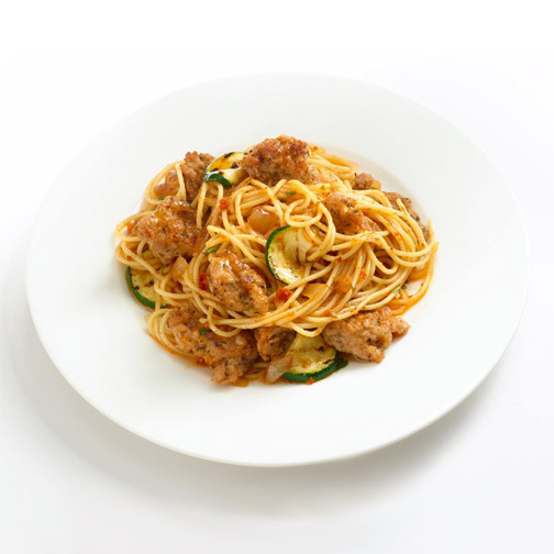 spaghetti with Premio pesto chicken sausage and zucchini