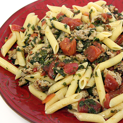 Premio sausage with pasta and tomatoes