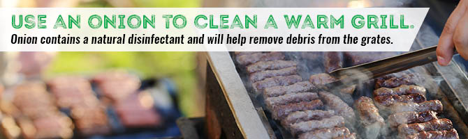 Use an onion to clean a warm grill