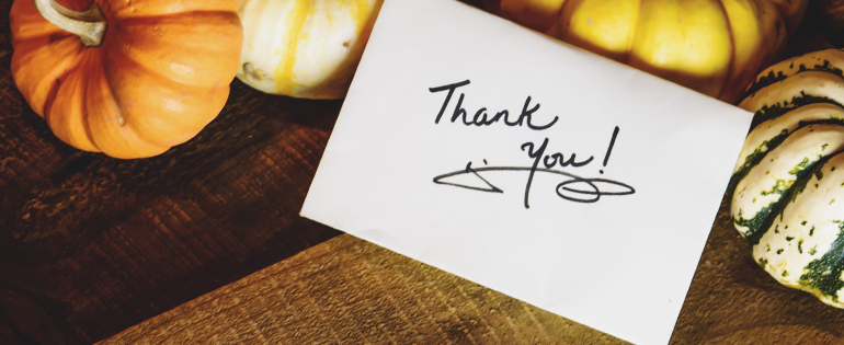 thank you note leaning on pumpkins