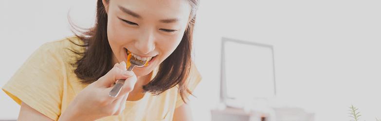 woman eating comfort food