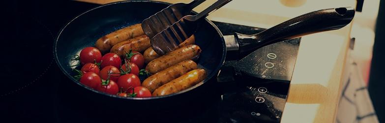 Sausage Cooking in Frying Pan