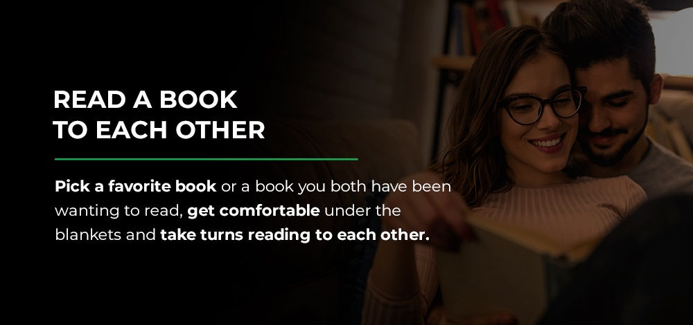 couple reading a book to each other