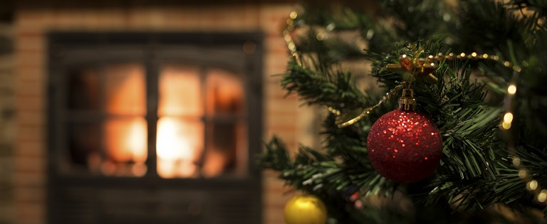 Christmas tree in front of fire place